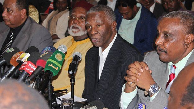 Thabo Mbeki (centre, in suit)