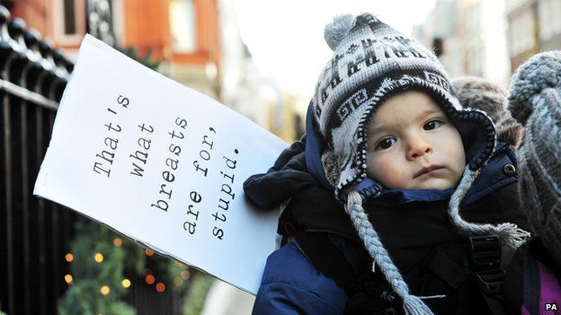 Baby and a sign outside Claridge's