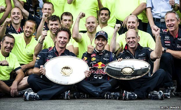 Red Bull Racing German driver Sebastian Vettel (C), Team Principal Christian Horner (L), and chief Technical Officer Adrian Newey (R), pose with their trophies after Vettel won the Belgium Formula One Grand Prix