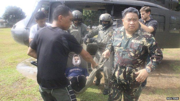 Lorenzo Vinciguerra, a Swiss wildlife photographer who was kidnapped by Islamist rebels more than two years ago, is carried by soldiers to Camp Bautista Station Hospital in the municipality of Jolo, province of Sulu, southern Philippines in this December 6