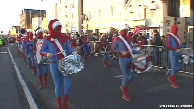 The procession included drum-playing Spider-Men