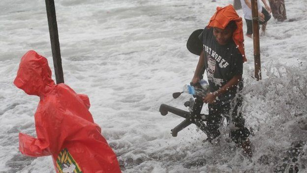 Boys salvage belongings as they return to their homes in Legazpi, Dec 8