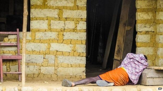 October 2014 photo, a man suffering from the Ebola virus near Freetown, Sierra Leone.