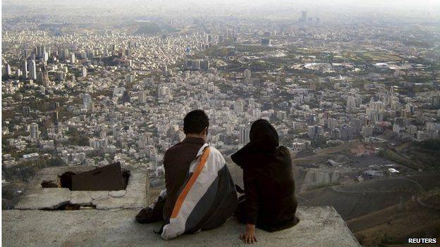 Iranian couple overlooking Tehran (file photo)