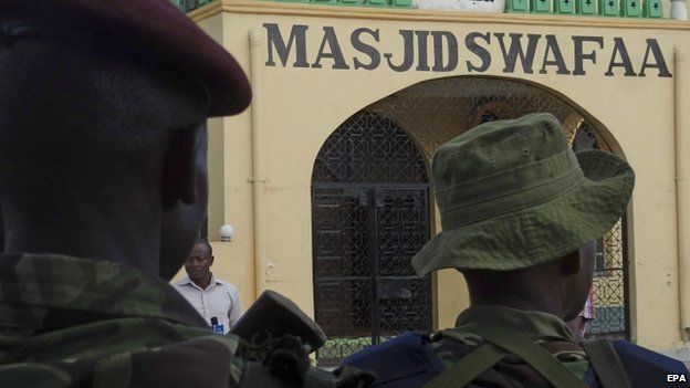 Kenyan police stand guard outside a mosque in Mombasa