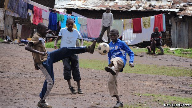 Boys play football on a dusty patch in Majengo slum in the outskirts of Nairobi.