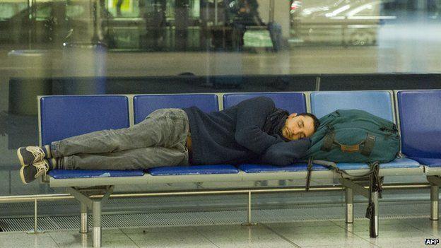 A passenger lying down at Gatwick