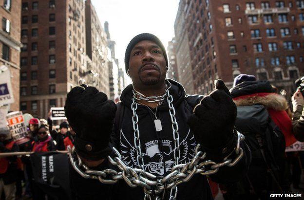 A marcher in Manhattan, New York, 13 December