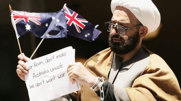 Man Haron Monis holds an Australian flag outside Downing Centre Local Court after having been charged over letters harassing families of Australian soldiers in Sydney, Australia, 10 November 2009.