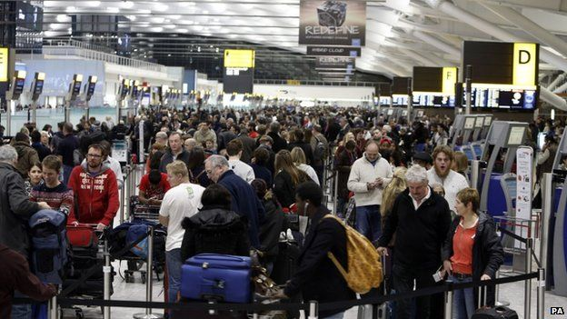 Queues of passengers at Heathrow airport, 12 December 2014