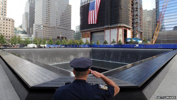 A police officer salutes near the September 11 Memorial in New York City.