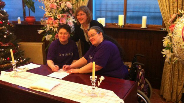 Leanne and Marie Banks signing the documents