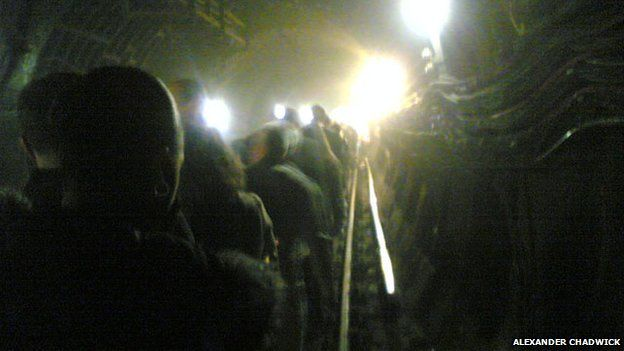 Commuters walking away from a bombed train