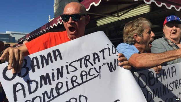 Protesters outside of Cafe Versailles on Calle Ocho in Miami protest on 17 December 2014
