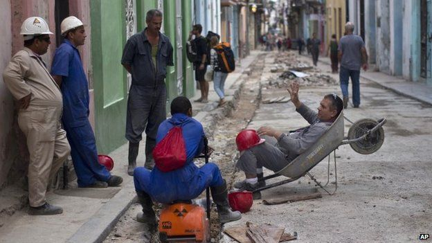 Construction workers speculate what Cuba's President Raul Castro will announce in an upcoming live, nationally broadcast speech in Havana on 17 December, 2014
