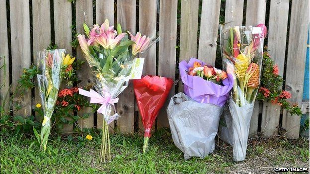 Floral tributes left outside the house in Cairns (19 Dec 2014)