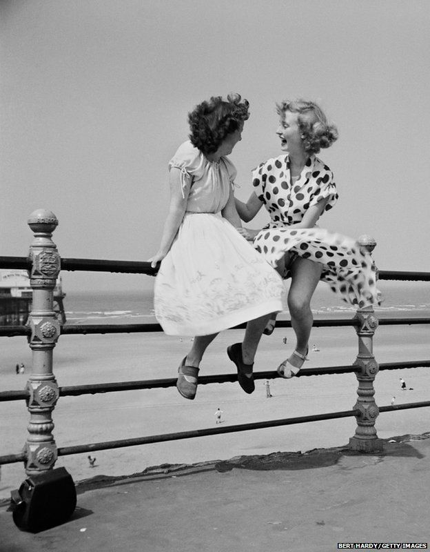 Bert Hardy captures two women chatting on the railings in Blackpool