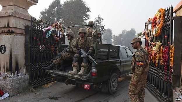Soldiers arriving at the Army Public School in Peshawar, scene of the massacre