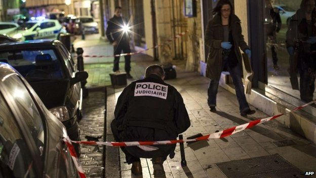 Police at the site where a driver targeted pedestrians in Dijon