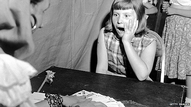 Fortune teller with surprised girl