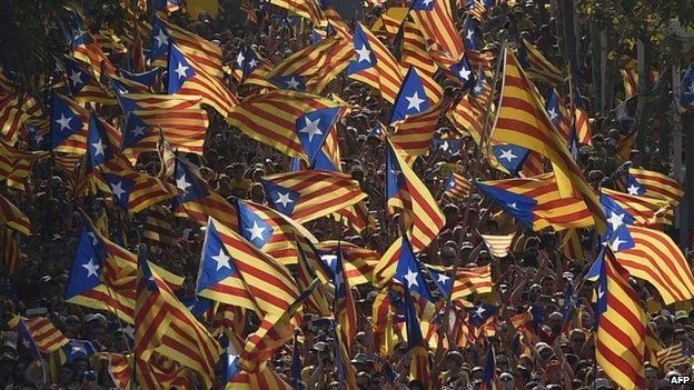 File photo: Catalan pro-independence flags are waved during celebrations of Catalonia National Day in Barcelona, 11 September 2014