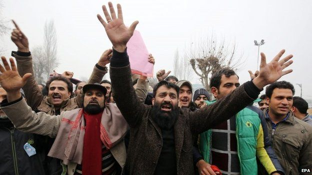 Supporters of People's Democratic Party (PDP) shout pro-party slogans after their candidates were declared winners of five out of eight seats in Srinagar