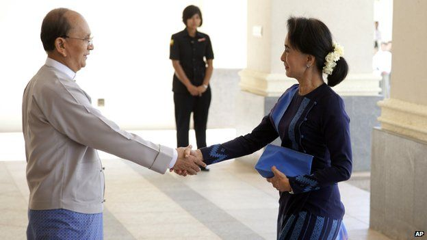 Myanmar President Thein Sein, left, shakes hands with Myanmar opposition leader Aung San Suu Kyi as they meet at Myanmar Presidential Palace in Naypyitaw, Myanmar, 31 Oc, 2014