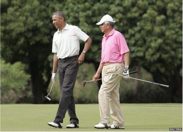 Obama and Razak playing golf on Christmas eve 2014