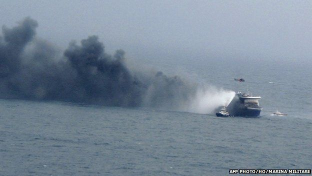 """A photo grab taken from a video made available by the Marina Militare Italiana on 28 December 2014, shows the burning ferry """"Norman Atlantic"""" adrift off Albania."""
