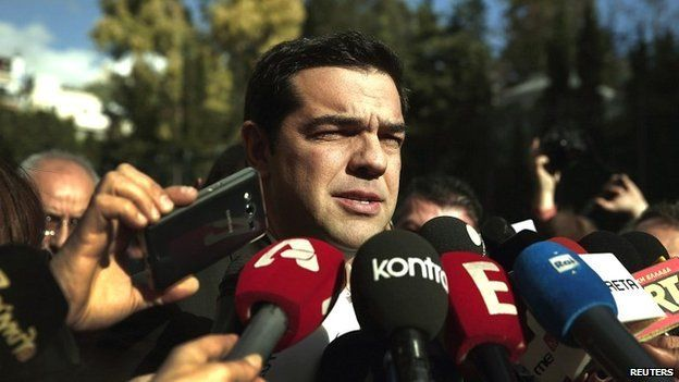 Alexis Tsipras, leader of the Syriza party, talks to reporters outside the parliament building in Athens - 29 December 2014