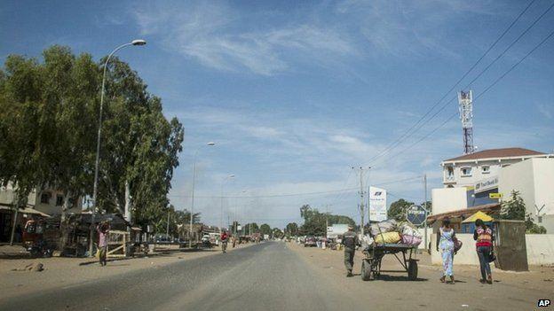 Residents walk on an empty street in Banjul, Gambia - 30 December 2014