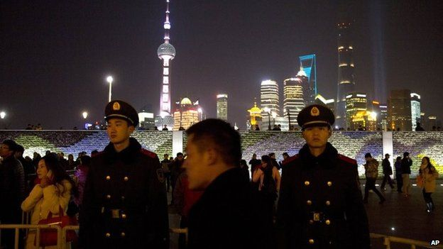 Chinese paramilitary policemen are deployed in the aftermath of a deadly stampede in Shanghai, China, 1 January 2015