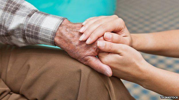 Elderly man receiving a home care visit
