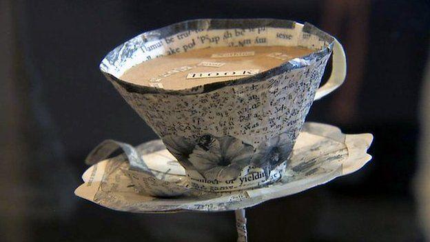 Paper sculpture of a teacup and saucer