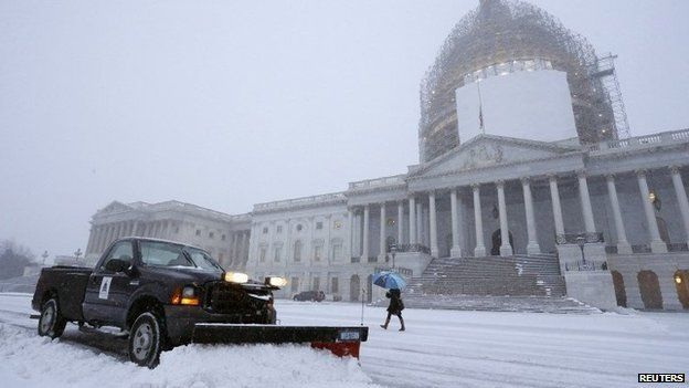 A light snow blankets the east front of the US Capitol 6 January 2015