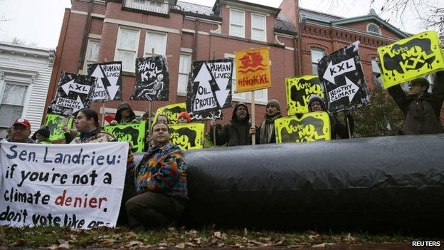 Climate advocates and representatives from the Rosebud Sioux Tribe protest against the Keystone XL pipeline 17 November 2014