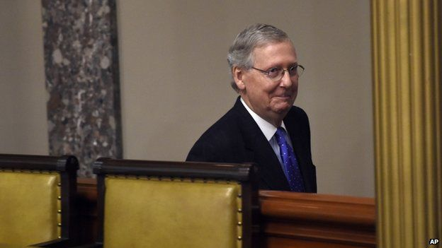 Senate Majority Leader Mitch McConnell of Ky. smiles following his ceremonial re-enactment swearing-in ceremony, Tuesday, Jan. 6, 2015,
