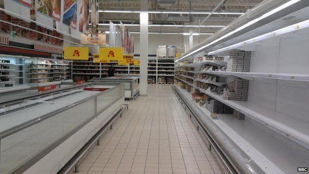 Empty shelves in a shop