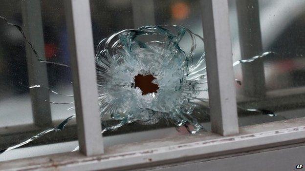 A bullet hole in a building near the Charlie Hebdo offices