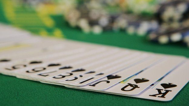 Playing cards and poker chips (c) Getty Images