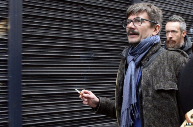 Charlie Hebdo cartoonist Luz arrives at the offices of Liberation in Paris, 9 January