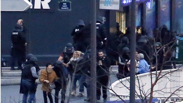 Police and hostages at a kosher food store in Porte de Vincennes, Paris, 9 January, 2013