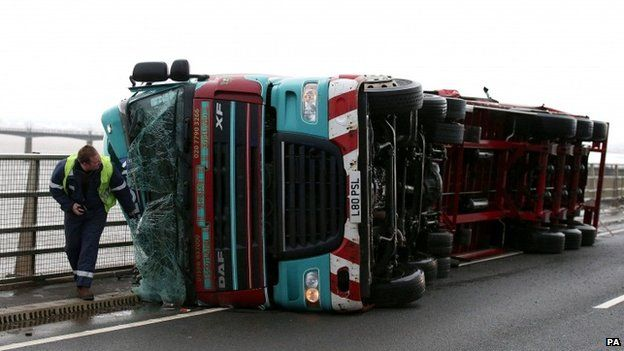 A lorry blown over in strong winds on the Clackmannanshire Bridge over the Firth of Forth