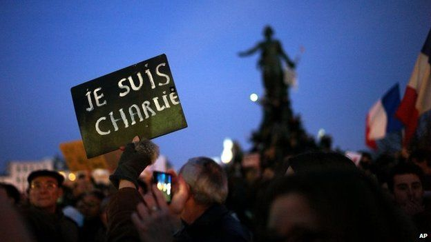"""A demonstrator holds a sign reading """"I am Charlie"""" at Place de la Nation during a rally in Paris, 11 January 2015"""