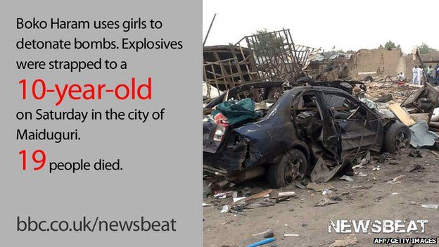 """Burned out car and words reading: """"Boko Haram uses girls to detonate bombs. Explosives were strapped to a 10-year-old on Saturday in the city of Maiduguri. 19 people died."""""""