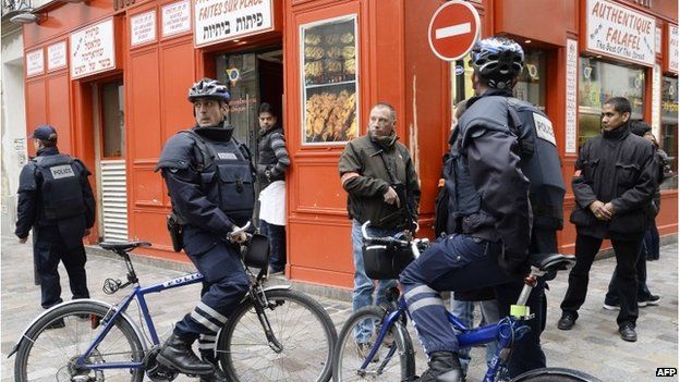 Police patrol in the Marais, a historic Jewish quarter in central Paris, 12 January 2015