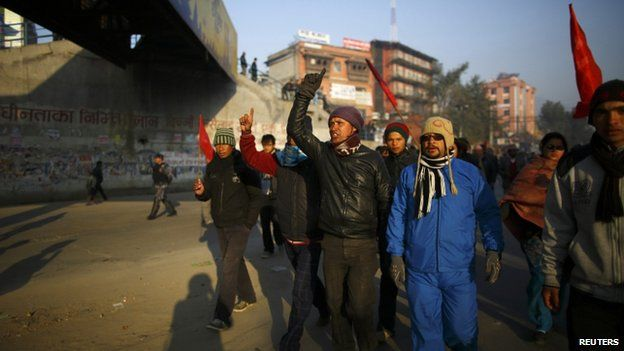 Protesters march along a deserted road during the general strike in Kathmandu 13 January 2015