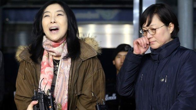 Korean-American Shin Eun-Mi (L) speaking to the media as she is deported from South Korea at an immigration office of Incheon airport while former leftist politician Hwang Sun (R), a pro-unification activist, stands with her.