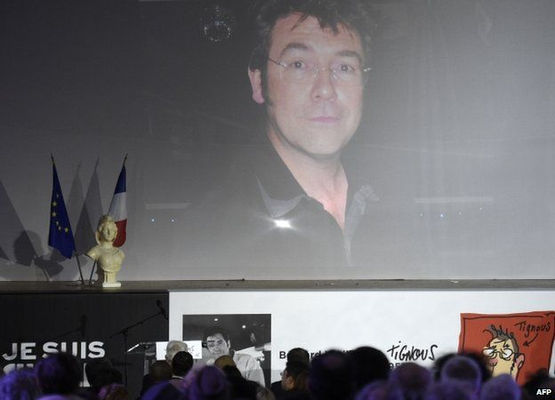 Photo of Tignous at funeral service - 15 January