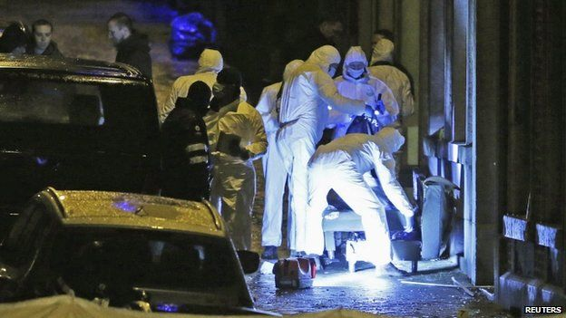 Forensic experts at the scene of the raid in Verviers. 15 Jan 2015